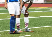 Two soccer players rest during a quick break in the action royalty free stock photos