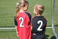 Two Soccer Twos. Siblings in reverse color soccer jerseys Stock Photo