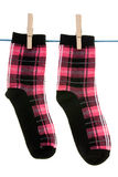 Two socks hang on rope Royalty Free Stock Photography