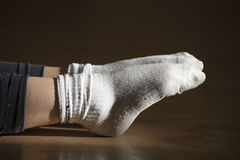 Two socks. In a room of the dance photo shooting feet of a dancer at rest with two white socks Royalty Free Stock Photo