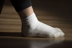 Two socks. In a room of the dance photo shooting feet of a dancer at rest with two white socks Stock Photo