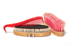 Two soft brushes and a comb-hoofpick combo. For grooming horses stock image