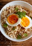 Two soft egg slices on chinese noodles Stock Photography