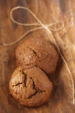 Two soft ginger cookies on wood, shallow dof Stock Image
