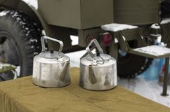 Two soldier`s aluminum retro teapots. Two soldier`s aluminum teapots. Reconstruction of soldier`s  life during the war Stock Image