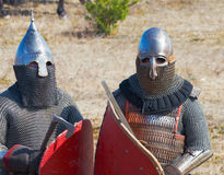 Two soldiers in an armor and with the weapon Stock Images