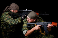 Two soldiers in camouflage uniform Stock Image
