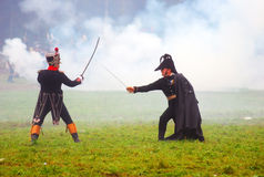 Two soldiers fight on swords Stock Images