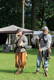 Two soldiers filling rifles with ammunition during Civil War re-enactment,Saratoga Springs,New York,Fall,2013 Royalty Free Stock Photo
