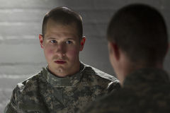 Two soldiers meeting in dark room, horizontal Stock Photos