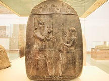 Two soldiers on relief panel from ancient Turkey inside historical gallery Stock Image