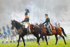 Two soldiers ride horses. Two soldiers ride horses and look at the battlefield. Borodino historical reenactment battle between Russian and French armies. Taken Royalty Free Stock Photography