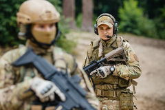 Two soldiers scout the area occupied by the enemy Stock Images