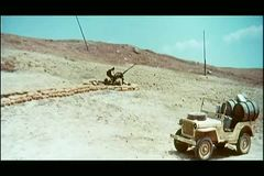 Two soldiers in a trench dodging nearby explosion stock video