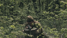 Two soldiers during war with rifles in the forest. Two soldiers during the war with rifles in the forest stock footage