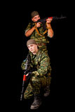 Two soldiers with weapon Stock Photos
