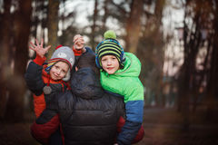 Two sons and his father, outdoor portrait. Father holding two sons. fun, joy, happiness, friendship Royalty Free Stock Image