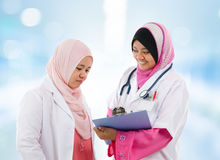 Two Southeast Asian Muslim medical doctor Royalty Free Stock Photo