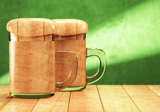 Two souvenir beer mugs with fake wooden beer Royalty Free Stock Photo