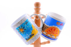 Two souvenir cups from Barcelona hanging on hanger. Isolated on white background Royalty Free Stock Photos