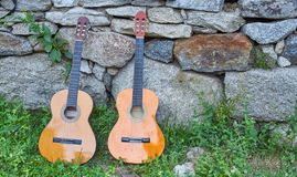 Two spanish guitars in the gound stock photo