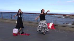 Two spanish woman dancing in Puerto De La Cruz street, Spain. TENERIFE, CANARY ISLANDS, SPAIN – November 2015: Two spanish woman dancing in Puerto De La Cruz stock video