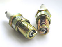 Two Spark Plugs. Together on white background Stock Image