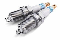 Two spark plugs on a white background royalty free illustration