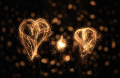 Two sparkler hearts at night Stock Photos