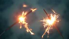 Two sparkler shining with blue background stock video footage