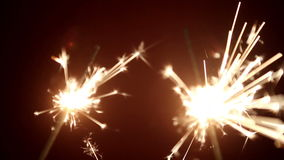 Two sparkler shining with red background. Two sparkler shining bright with red background stock footage