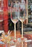 Two sparkling champaign glasses. On a beautifully decorated glass table during holidays and festivities royalty free stock photos