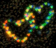 Two sparkling hearts bokeh Stock Photography