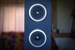 Two speakers of a sound tower in the living room stock photo