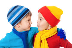 Two speaking kids in winter clothes. Showing a different emotions, isolated on white Stock Photo