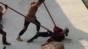 Two spearmen kill an opponent who dies in pain lying on the floor stock video