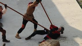 Two spearmen kill an opponent who dies in pain lying on the floor stock footage