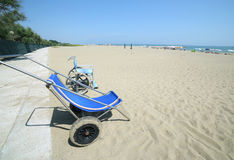 Two special wheelchairs to go on the sandy beach. To the sea Stock Photos