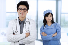 Two specialist doctors folded arms Royalty Free Stock Image