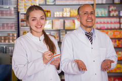 Two specialists  in drugstore Stock Photos