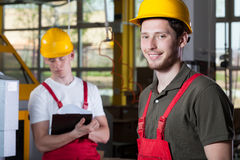 Two specialists working at factory Royalty Free Stock Images
