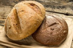 Two species of bread on paper bag Royalty Free Stock Image