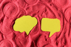 Two speech bubble on red sand Royalty Free Stock Images