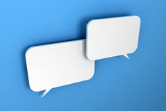 Two speech bubbles. Two white speech bubbles over light blue, textured wall Royalty Free Stock Images