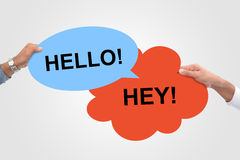 Two Speech Bubbles meeting. Hello Hey! Royalty Free Stock Image