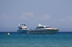 Two speedboats at anchor. Saint-tropez, french riviera - adobe RGB royalty free stock photography
