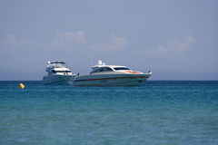 Two speedboats at anchor Stock Photos
