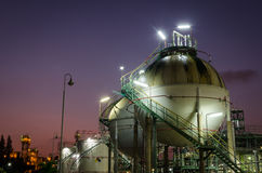 Two sphere gas storages  petrochemical plant at twilight. Two sphere gas storages in petrochemical plant at twilight Royalty Free Stock Image