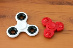 Two spinners on wooden background.  stock images