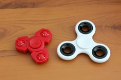 Two spinners on wooden background.  royalty free stock photo